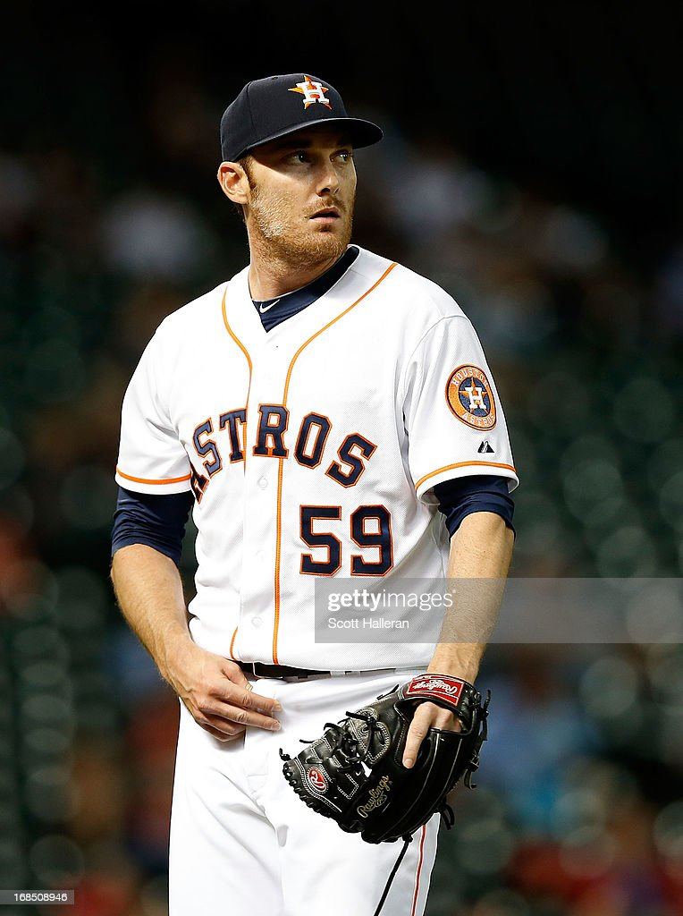 <a gi-track='captionPersonalityLinkClicked' href=/galleries/search?phrase=Philip+Humber&family=editorial&specificpeople=836505 ng-click='$event.stopPropagation()'>Philip Humber</a> #59 of the Houston Astros walks to the dugout during the game against the Los Angeles Angels of Anaheim at Minute Maid Park on May 9, 2013 in Houston, Texas.