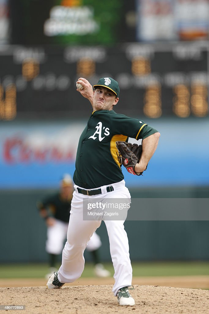 <a gi-track='captionPersonalityLinkClicked' href=/galleries/search?phrase=Philip+Humber&family=editorial&specificpeople=836505 ng-click='$event.stopPropagation()'>Philip Humber</a> #47 of the Oakland Athletics pitches during a spring training game against the Milwaukee Brewers at Phoenix Municipal Stadium on February 27, 2014 in Phoenix, Arizona.