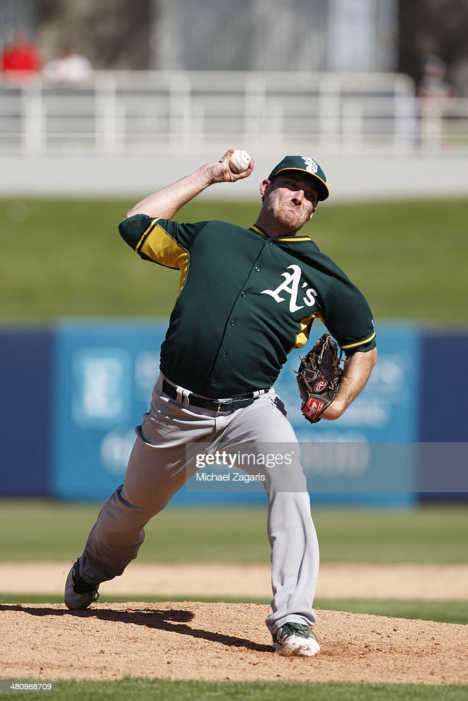 <a gi-track='captionPersonalityLinkClicked' href=/galleries/search?phrase=Philip+Humber&family=editorial&specificpeople=836505 ng-click='$event.stopPropagation()'>Philip Humber</a> #47 of the Oakland Athletics pitches during a spring training game against the Milwaukee Brewers at Maryvale Baseball Park on March 5, 2014 in Phoenix, Arizona.