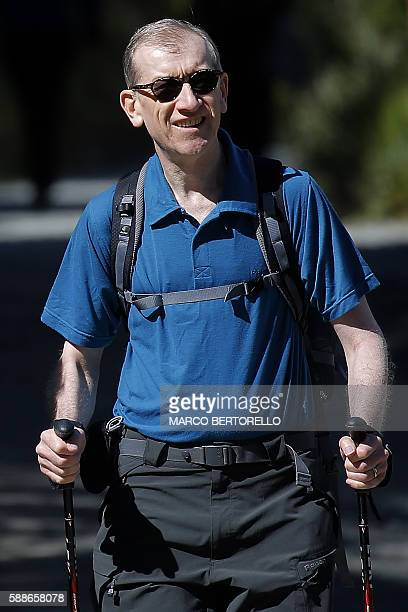 Philip John May husband of British Prime Minister Theresa May walks in a forest at the start of a summer holiday in the Alps in Switzerland on August...