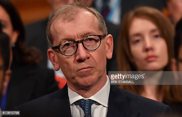 Philip John May the husband of British Prime Minister Theresa May listens as his wife delivers a keynote address on the final day of the annual...
