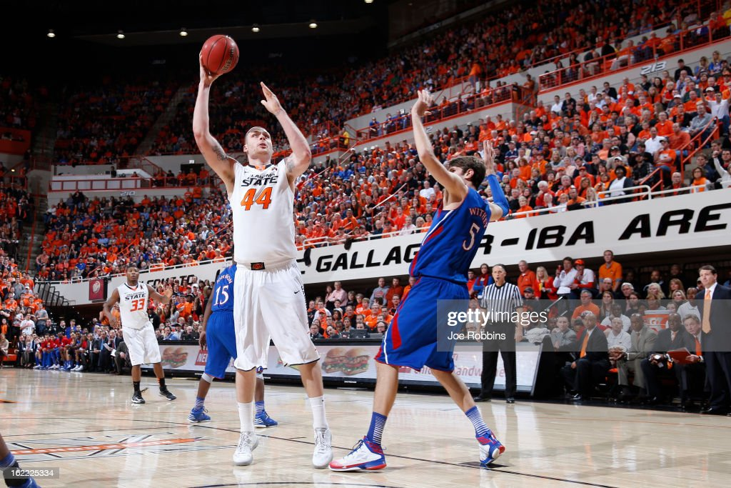 Philip Jurick #44 of the Oklahoma State Cowboys goes to the basket against <a gi-track='captionPersonalityLinkClicked' href=/galleries/search?phrase=Jeff+Withey&family=editorial&specificpeople=6669172 ng-click='$event.stopPropagation()'>Jeff Withey</a> #5 of the Kansas Jayhawks during the game at Gallagher-Iba Arena on February 20, 2013 in Stillwater, Oklahoma. Kansas won 68-67 in two overtimes.