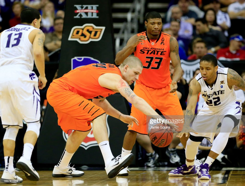 Philip Jurick #44 of the Oklahoma State Cowboys looks to control the ball against Rodney McGruder #22 of the Kansas State Wildcats in the first half during the Semifinals of the Big 12 basketball tournament at the Sprint Center on March 15, 2013 in Kansas City, Missouri.