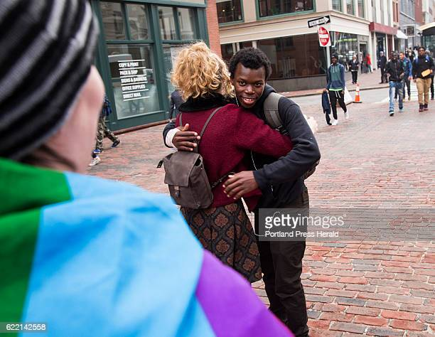Philip Kana a Deering High School student gets a hug from Jackie King center who along with two other women decided to offer free hugs in Monument...