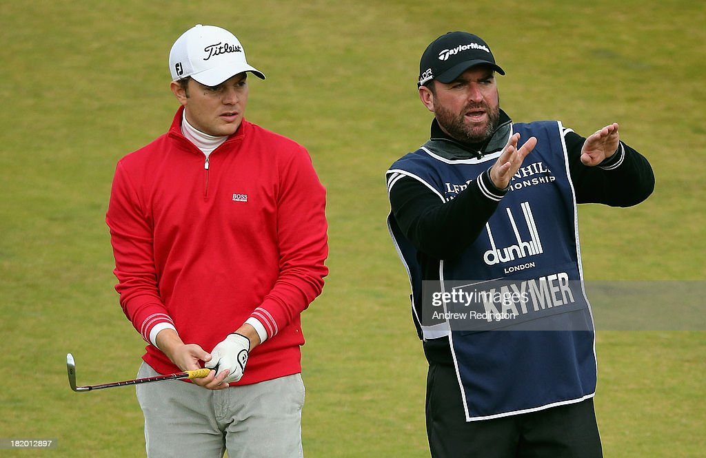 Philip Kaymer talks with caddie Craig Connelly during the second round of the Alfred Dunhill Links Championship at Kingsbarns Golf Links on September 27, 2013 in Kingsbarns, Scotland.