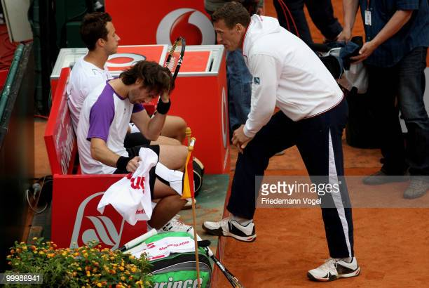 Philip Kohlschreiber Christopher Kas and national coach Patrick Kuehnen of Germany look on during the double match against Juan Monaco and Horacio...