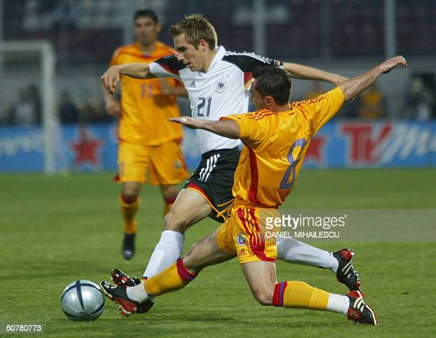 Philip Lahm from Germany fights for the ball with Florentin Petre of Romania in the friendly match Germany vs Romania in Bucharest 28 April 2004 AFP...