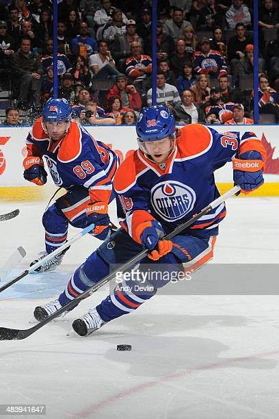 Philip Larsen and Sam Gagner of the Edmonton Oilers skate on the ice in a game against the Los Angeles Kings on April 10 2014 at Rexall Place in...