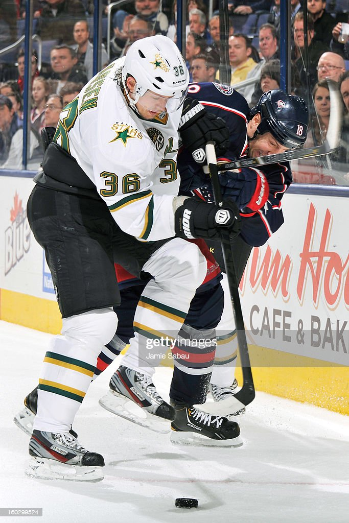 Philip Larsen #36 of the Dallas Stars and R.J. Umberger #18 of the Columbus Blue Jackets battle for control of the puck in the third period on January 28, 2013 at Nationwide Arena in Columbus, Ohio. Columbus defeated Dallas 2-1.
