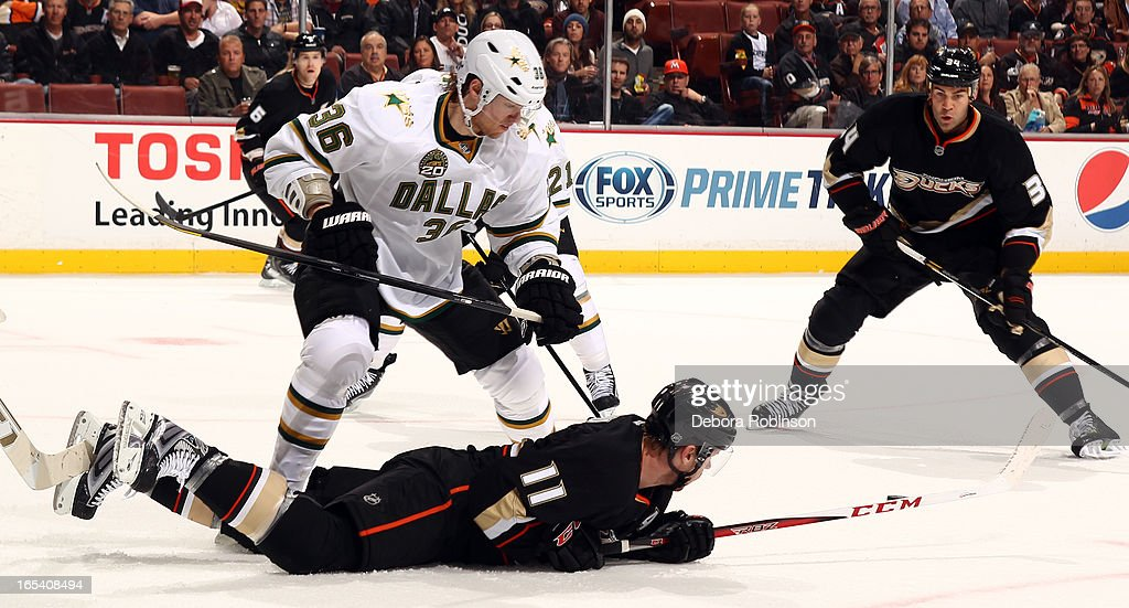 Philip Larsen #36 of the Dallas Stars skates over a fallen Saku Koivu #39 of the Anaheim Ducks on April 3, 2013 at Honda Center in Anaheim, California.