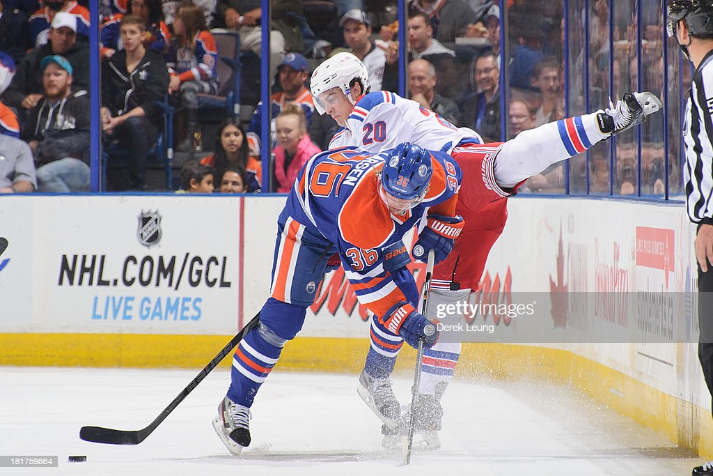 <a gi-track='captionPersonalityLinkClicked' href=/galleries/search?phrase=Philip+Larsen&family=editorial&specificpeople=5370941 ng-click='$event.stopPropagation()'>Philip Larsen</a> #36 of the Edmonton Oilers collides with <a gi-track='captionPersonalityLinkClicked' href=/galleries/search?phrase=Chris+Kreider&family=editorial&specificpeople=5894671 ng-click='$event.stopPropagation()'>Chris Kreider</a> #20 of the New York Rangers during a preseason NHL game at Rexall Place on September 24, 2013 in Edmonton, Alberta, Canada.