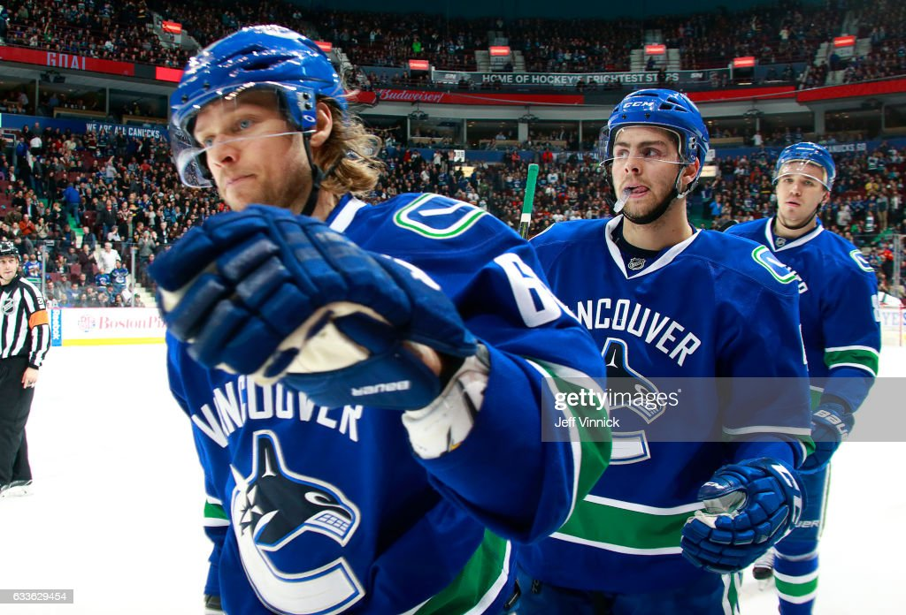 Philip Larsen #63 of the Vancouver Canucks is congratulated by teammates after scoring during their NHL game at Rogers Arena February 2, 2017 in Vancouver, British Columbia, Canada. San Jose won 4-1.