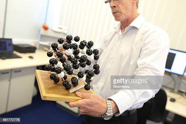 Philip Martineau head of physics at the De Beers Research Centre holds a molecular model of a diamond at De Beers Technologies research laboratory in...