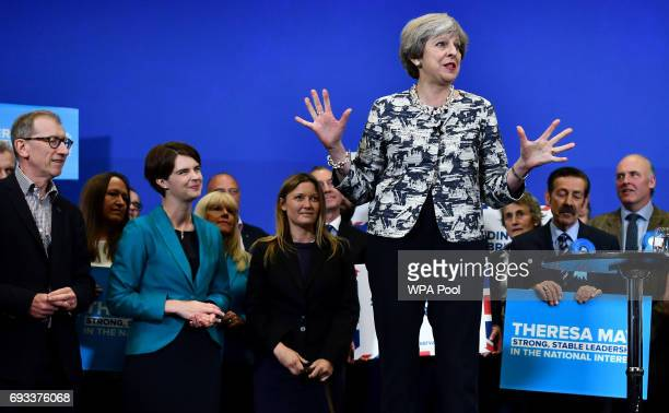 Philip May husband of Britain's Prime Minister and leader of the Conservative Party Theresa May listens as she speaks during a Conservative Party...