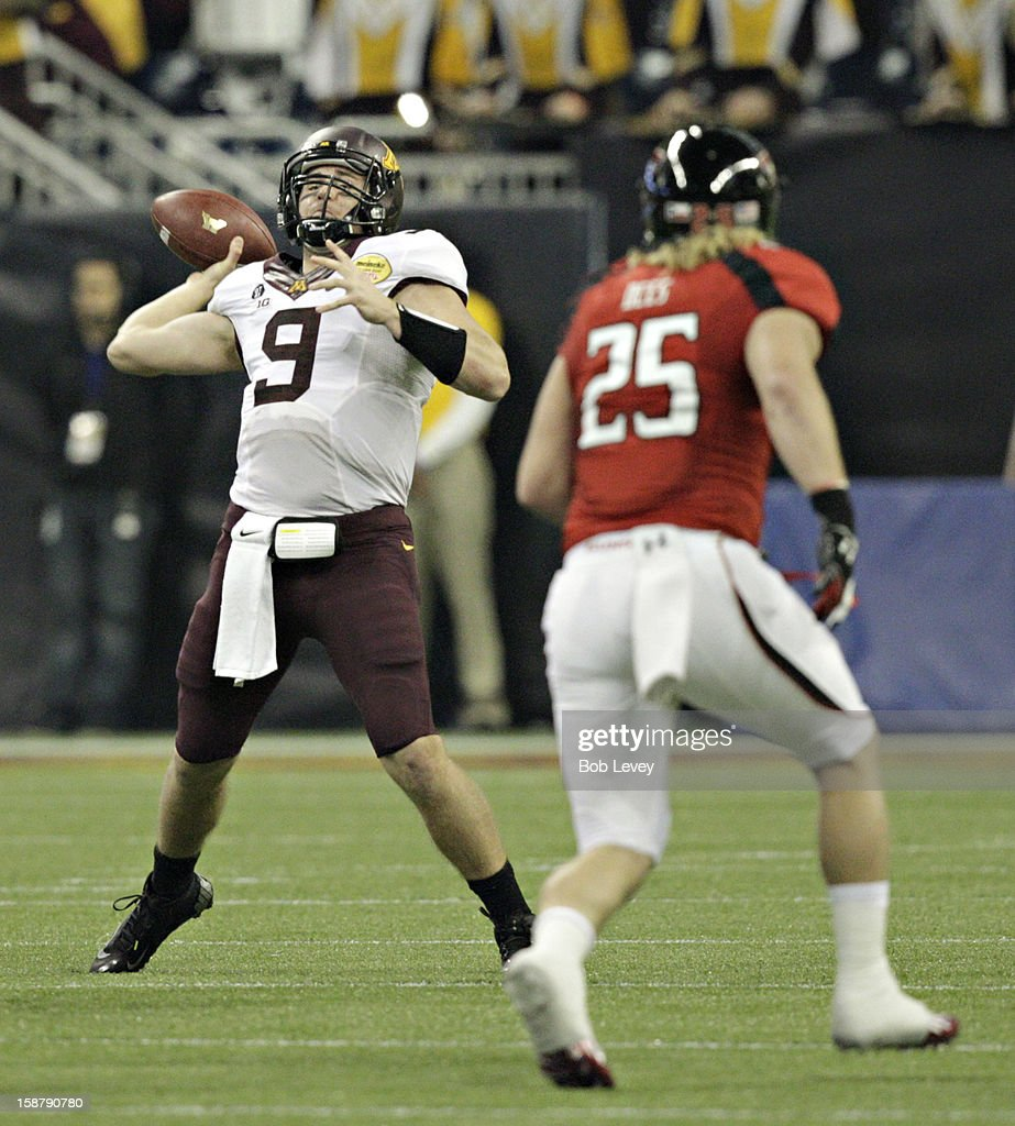 Philip Nelson #9 of the Minnesota Golden Gophers throws down-field as Blake Dees #25 of the Texas Tech Red Raiders applies pressure during the Meineke Car Care of Texas Bowl at Reliant Stadium on December 28, 2012 in Houston, Texas. Texas Tech defeated Minnesota 34-31.