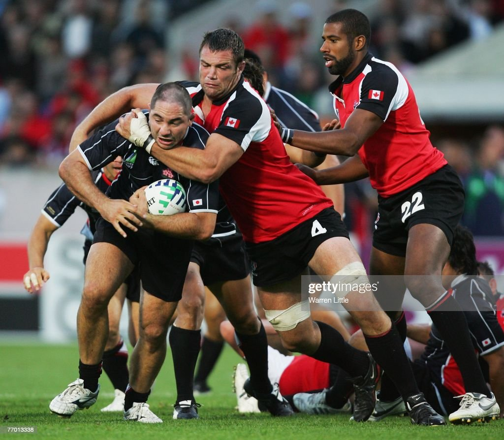 Philip O'Reilly of Japan is tackled by Mike Burak of Canada during the Rugby World Cup Pool B match between Canada and Japan at the Stade Chaban...