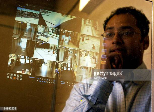 CAMERAS 10/06/04 Philip Parappally looks at the digital video recorder at Fossil Hill Public School This machine is tucked away in a secure room...