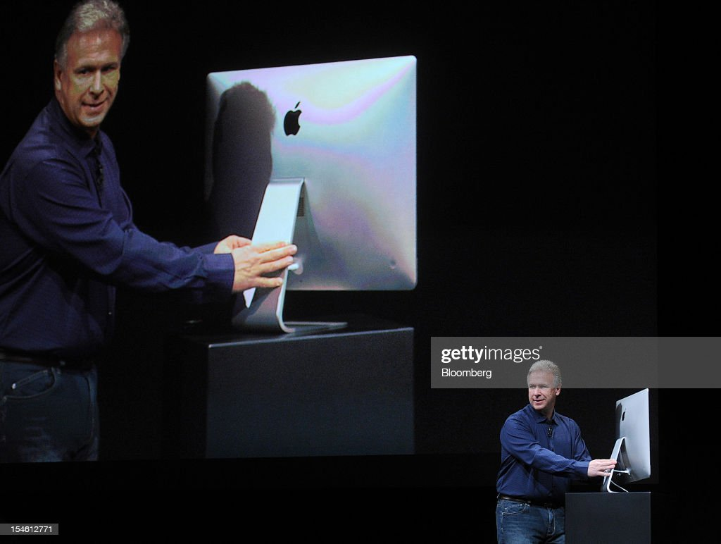 Philip 'Phil' Schiller, senior vice president of worldwide marketing at Apple Inc., discusses the iMac during an event in San Jose, California, U.S., on Tuesday, Oct. 23, 2012. Apple Inc. introduced a 13-inch MacBook Pro with a high-definition display and thinner profile, as the company adds more features to its line of computer notebooks. Photographer: Noah Berger/Bloomberg via Getty Images
