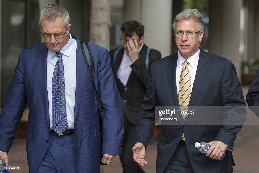 Philip 'Phil' Schiller, senior vice president of worldwide marketing at Apple Inc., right and Bruce Sewell, senior vice president and general counsel at Apple Inc., exit the Robert Peckham United States Federal Court Building in San Jose, California, U.S., on Tuesday, April 1, 2014. Samsung Electronics Co. told jurors at the opening of a $2 billion trial that Apples patent case is really an attack on Google Inc.s Android operating system and a ploy to stem smartphone competition that has overwhelmed iPhone sales. Photographer: David Paul Morris/Bloomberg via Getty Images
