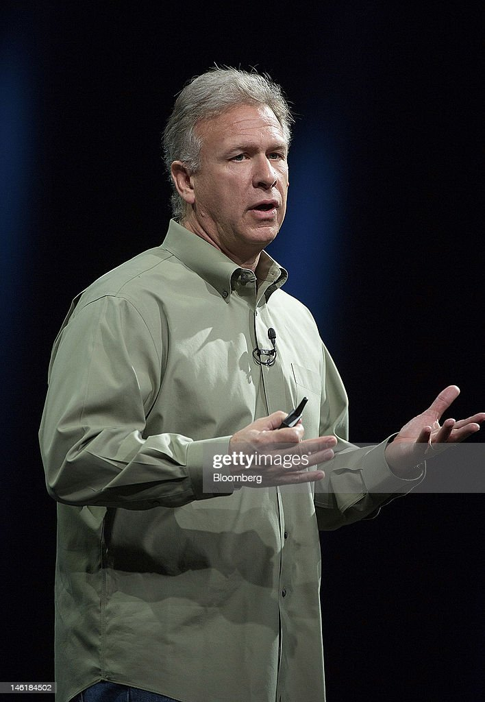 Philip 'Phil' Schiller, senior vice president of worldwide marketing for Apple Inc., displays the new MacBook Pro laptop computer while speaking at the Apple Worldwide Developers Conference in San Francisco, California, U.S., on Monday, June 11, 2012. Apple Inc. is releasing a fresh lineup of computers and software tools to woo consumers and keep developers making applications amid accelerating rivalry from Google Inc., Microsoft Corp. and, now, Facebook Inc. Photographer: David Paul Morris/Bloomberg via Getty Images