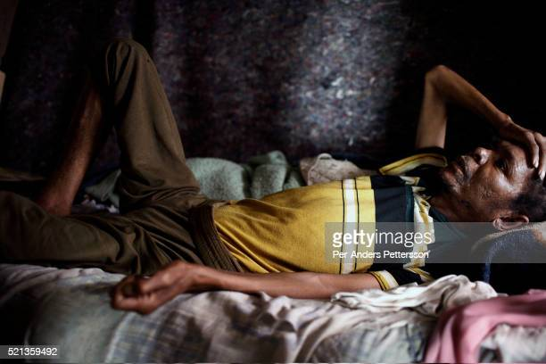 Philip Ramele age 52 rests in his bed in Soweto Johannesburg South Africa He has lived with HIV/Aids since 2000 and the lives in a small tworoom...