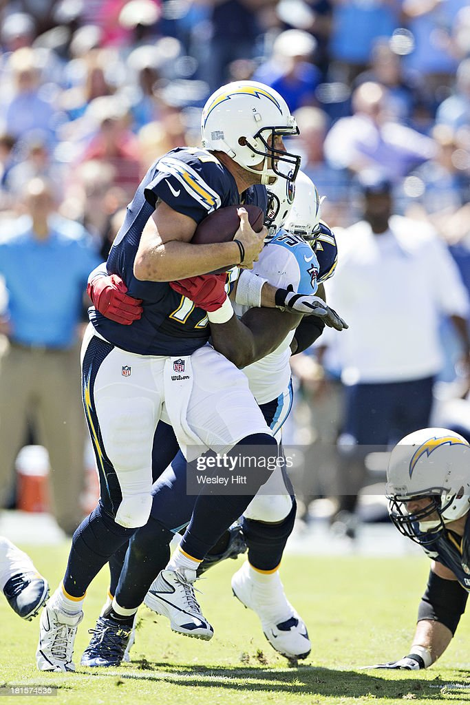 <a gi-track='captionPersonalityLinkClicked' href=/galleries/search?phrase=Philip+Rivers&family=editorial&specificpeople=212885 ng-click='$event.stopPropagation()'>Philip Rivers</a> #17 of the San Diego Chargers is sacked by <a gi-track='captionPersonalityLinkClicked' href=/galleries/search?phrase=Akeem+Ayers&family=editorial&specificpeople=5543453 ng-click='$event.stopPropagation()'>Akeem Ayers</a> #56 of the Tennessee Titans at LP Field on September 22, 2013 in Nashville, Tennessee. The Titans defeated the Chargers 20-17.