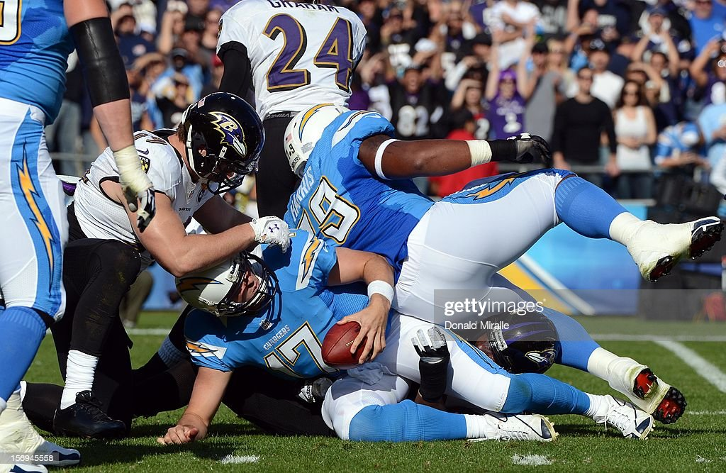 Philip Rivers #17 of the San Diego Chargers is sacked by the defense of the Baltimore Ravens on November 25, 2012 at Qualcomm Stadium in San Diego, California.