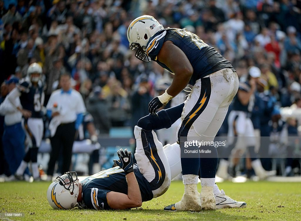 Philip Rivers #17 of the San Diego Chargers lies on the ground after getting tackled by a player from the Oakland Raiders on December 30, 2012 at Qualcomm Stadium in San Diego, California.