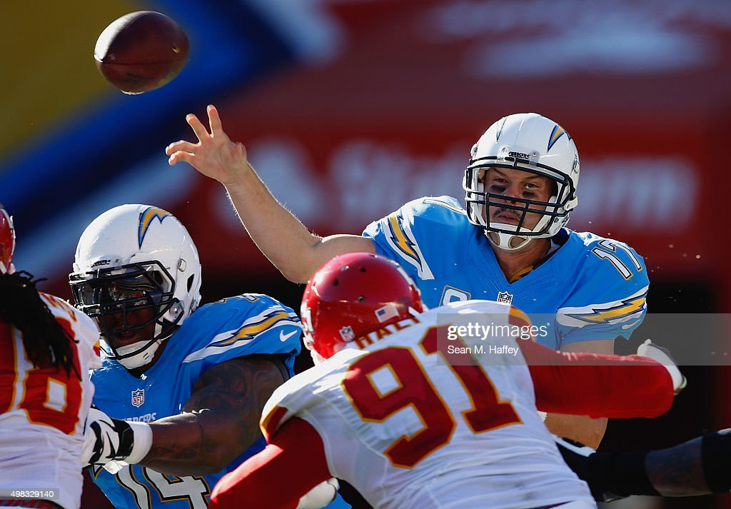 <a gi-track='captionPersonalityLinkClicked' href=/galleries/search?phrase=Philip+Rivers&family=editorial&specificpeople=212885 ng-click='$event.stopPropagation()'>Philip Rivers</a> #17 of the San Diego Chargers passes the ball under pressure from <a gi-track='captionPersonalityLinkClicked' href=/galleries/search?phrase=Tamba+Hali&family=editorial&specificpeople=630576 ng-click='$event.stopPropagation()'>Tamba Hali</a> #91 of the Kansas City Chiefs during the second half of a game at Qualcomm Stadium on November 22, 2015 in San Diego, California.