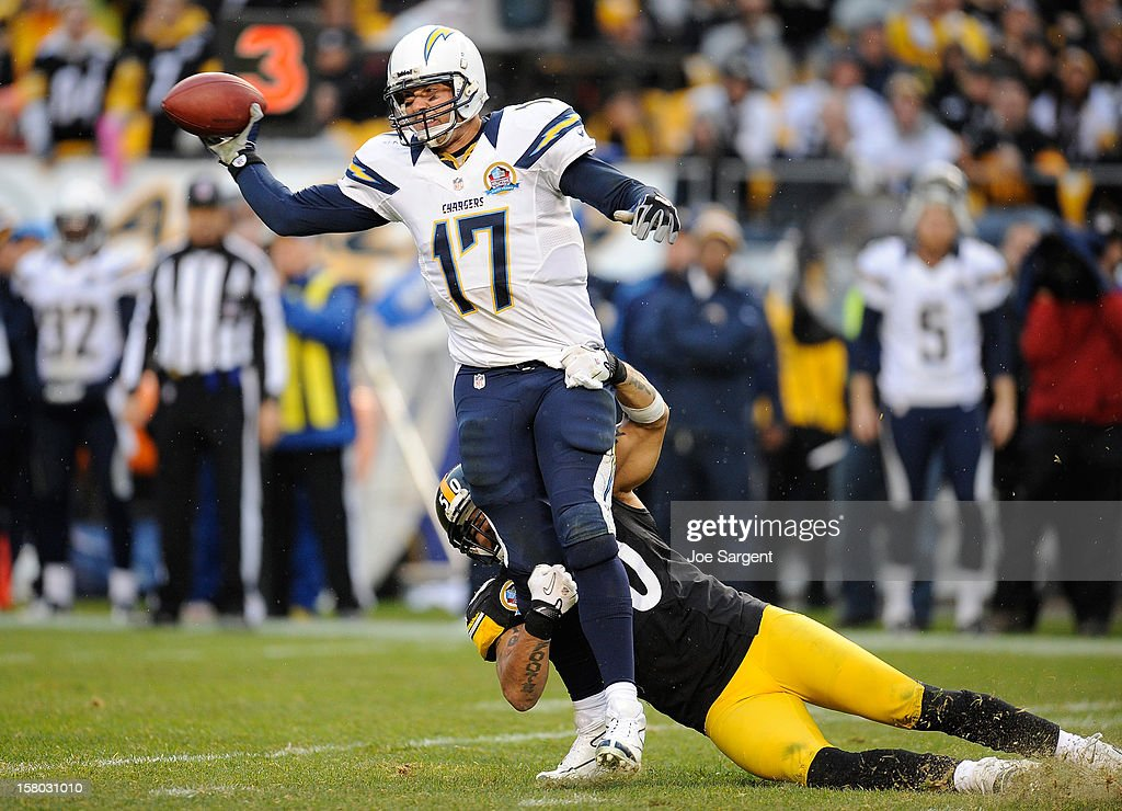 Philip Rivers #17 of the San Diego Chargers throws a pass before being dragged down by Larry Foote #50 of the Pittsburgh Steelers on December 9, 2012 at Heinz Field in Pittsburgh, Pennsylvania.