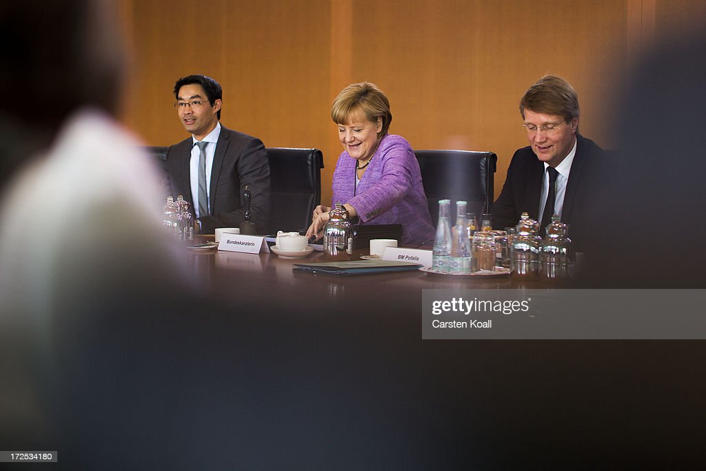 Philip Roesler, German Minister for Economics, German Chancellor Angela Merkel and Minister of the Chancellery Ronald Pofalla attend the weekly cabinet meeting at the Chancellery (Bundeskanzleramt) on July 3, 2013 in Berlin, Germany.