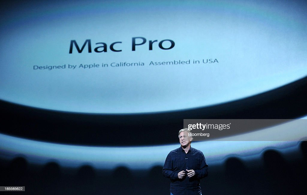 Philip Schiller, senior vice president of worldwide marketing at Apple Inc., unveils the MacBook Air and MacBook Pro laptops during a press event at the Yerba Buena Center in San Francisco, California, U.S., on Tuesday, Oct. 22, 2013. Apple Inc. introduced new iPads in time for holiday shoppers, as it battles to stay ahead of rivals in the increasingly crowded market for tablet computers. Photographer: Noah Berger/Bloomberg via Getty Images