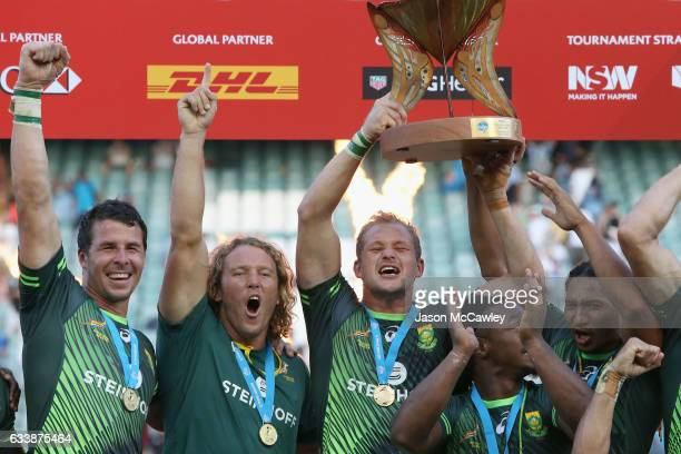Philip Snyman of South Africa holds aloft the cup after winning the Cup Final match between England and South Africa in the 2017 HSBC Sydney Sevens...