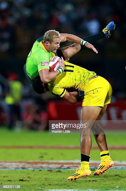 Philip Snyman of South Africa is dumped by Pama Fou of Australia leading to a yellow card in the Cup Final match between South Africa and Australia...