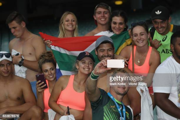 Philip Snyman of South Africa poses for a selfie with the crowd as he celebrates winning the Cup Final match between England and South Africa in the...