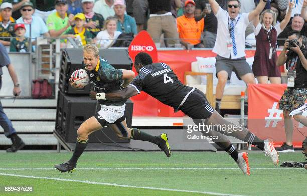 Philip Snyman of South Africa scores a try during day 2 of the 2017 HSBC Cape Town Sevens Semi Final match between South Africa and New Zealand at...