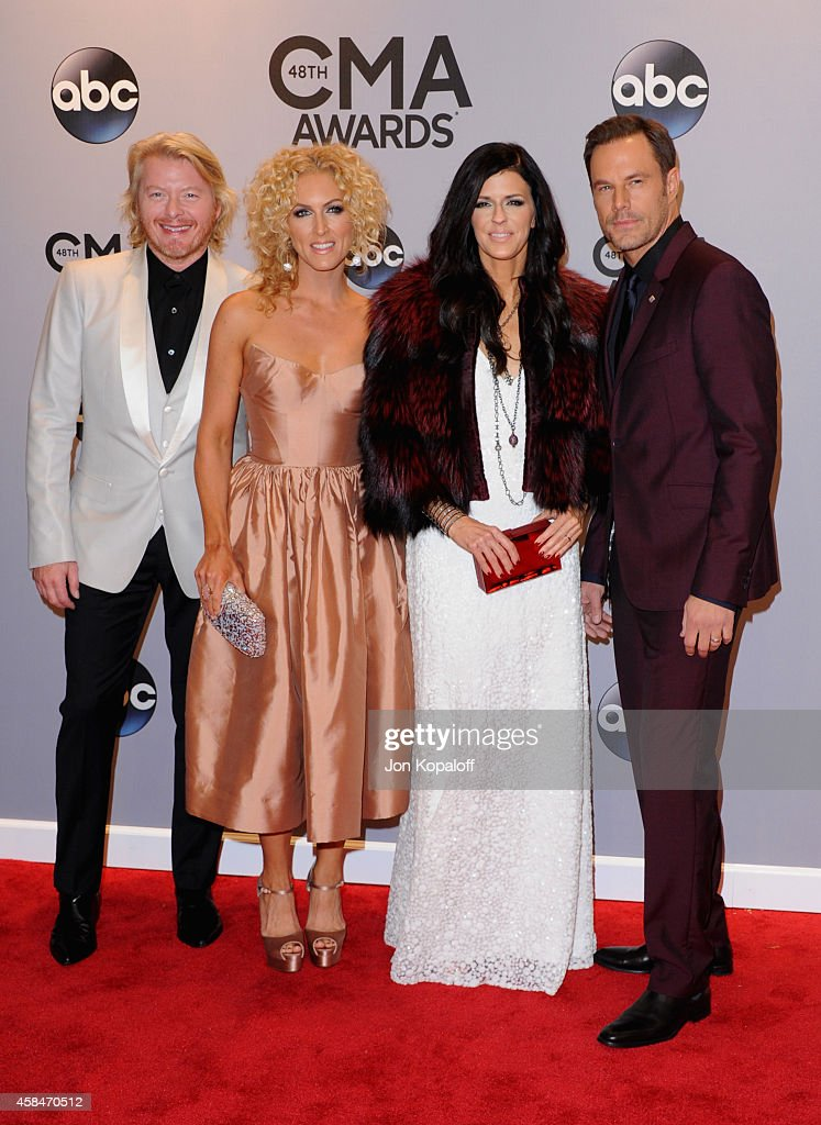 Philip Sweet Kimberly Schlapman Karen Fairchild and Jimi Westbrook of Little Big Town attend the 48th annual CMA Awards at the Bridgestone Arena on...