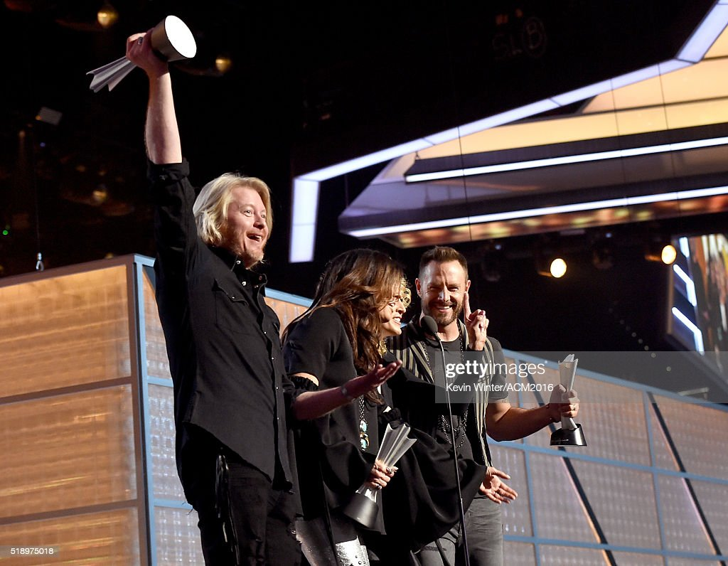 Philip Sweet Kimberly Schlapman Karen Fairchild and Jimi Westbrook of Little Big Town accept the Vocal Group of the Year award onstage during the...