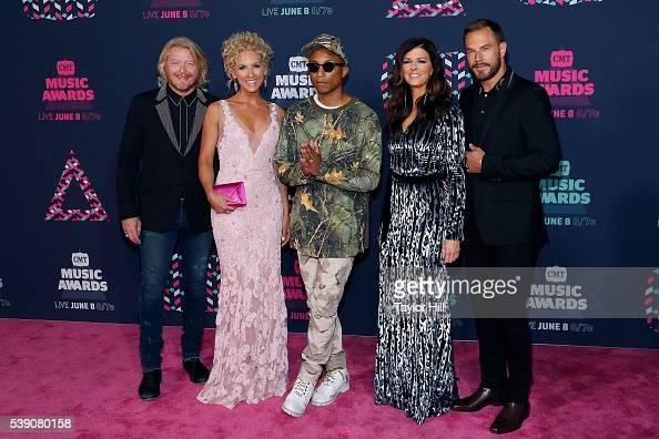 Philip Sweet Kimberly Schlapman Pharrell Williams Karen Fairchild and Jimi Westbrook attend the 2016 CMT Music awards at the Bridgestone Arena on...
