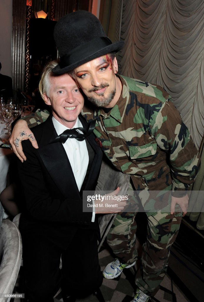 <a gi-track='captionPersonalityLinkClicked' href=/galleries/search?phrase=Philip+Treacy+-+Fashion+Designer&family=editorial&specificpeople=12819932 ng-click='$event.stopPropagation()'>Philip Treacy</a> (L) and <a gi-track='captionPersonalityLinkClicked' href=/galleries/search?phrase=Boy+George&family=editorial&specificpeople=203135 ng-click='$event.stopPropagation()'>Boy George</a> attend the Isabella Blow: Fashion Galore! charity dinner hosted by the Isabella Blow Foundation at Claridges Hotel on November 19, 2013 in London, England.
