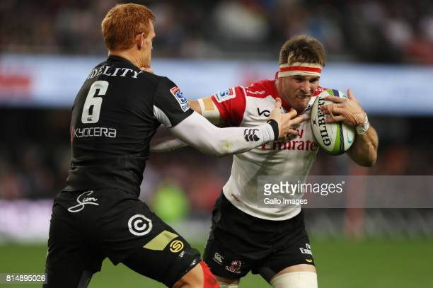 Philip van der Walt of the Cell C Sharks tackling Jaco Kriel of the Emirates Lions during the Super Rugby match between Cell C Sharks and Emirates...