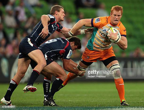 Philip van der Walt of the Cheetahs is tackled during the round three Super Rugby match between the Melbourne Rebels and the Cheetahs at AAMI Park on...