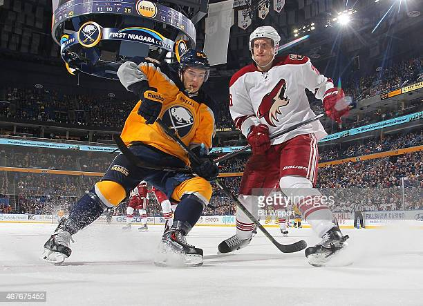 Philip Varone of the Buffalo Sabres skates against Michael Stone of the Arizona Coyotes on March 26 2015 at the First Niagara Center in Buffalo New...