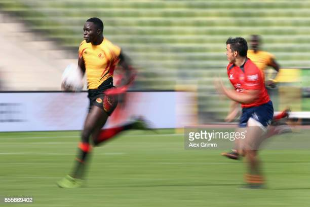 Philip Wokorach of Uganda eludes Marcelo Torrealba of Chile during the match between Uganda and chile on Day 2 of the Rugby Oktoberfest 7s tournament...