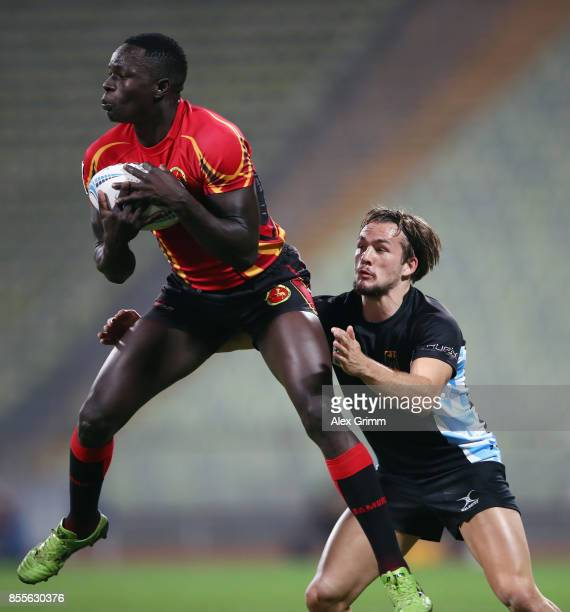 Philip Wokorach of Uganda is tackled by Bastian Himmer of Germany during the match between Germany and Uganda on Day 1 of the Rugby Oktoberfest 7s...