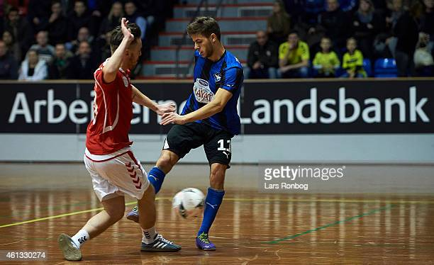 Philip Zinckernagel of HB Koge and Viljomur Davidsen of Vejle Boldklub compete for the ball during the Arbejdernes Landsbank Cup at Brondby Hallen on...