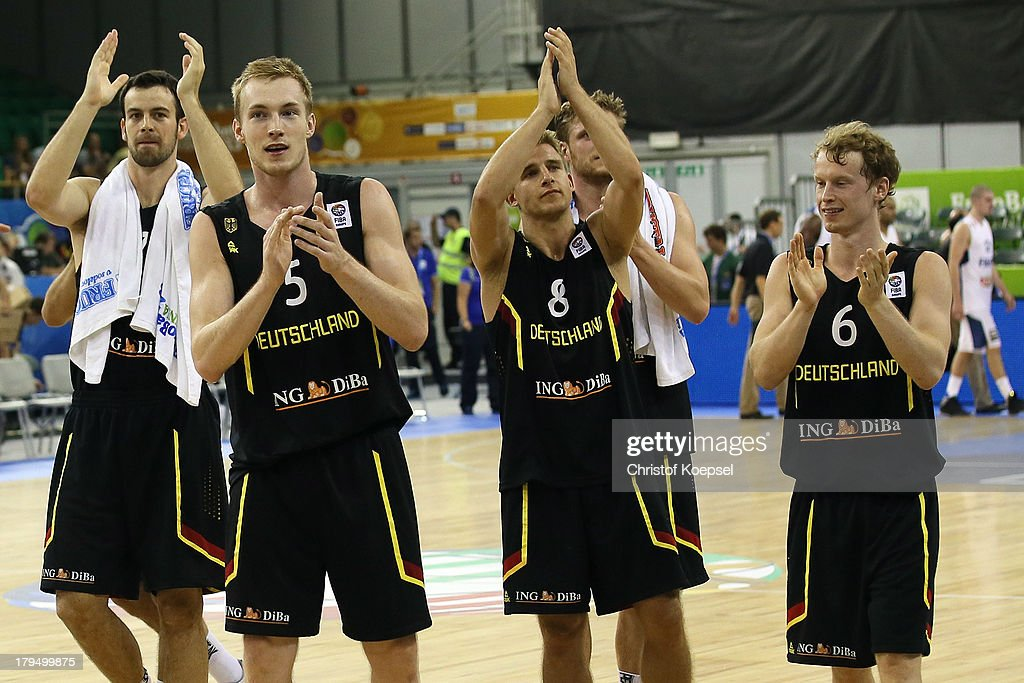 Philip Zwiener, Niels Giffey, Heiko Schaffartzik and Per Guenther of Gemany celebrate after the FIBA European Championships 2013 first round group A match between France and Germany at Tivoli Arena on September 4, 2013 in Ljubljana, Slovenia.