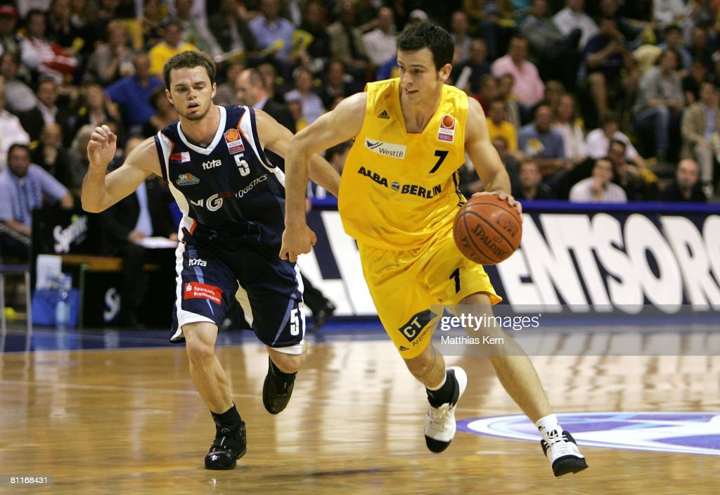 Philip Zwiener of Berlin challenges for the ball with Nate Funk of Bremerhaven during the Basketball PlayOff match between Alba Berlin and Eisbaeren...