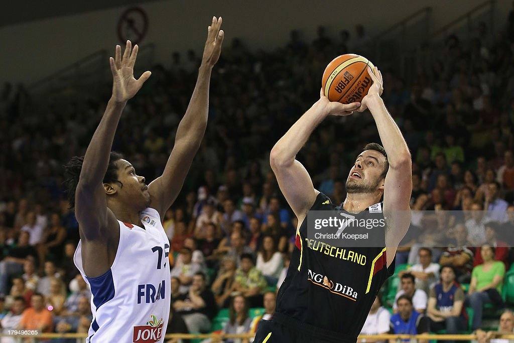 Philip Zwiener of Gemany (R) shoots over Mickael Gelabale of France (L) during the FIBA European Championships 2013 first round group A match between France and Germany at Tivoli Arena on September 4, 2013 in Ljubljana, Slovenia.