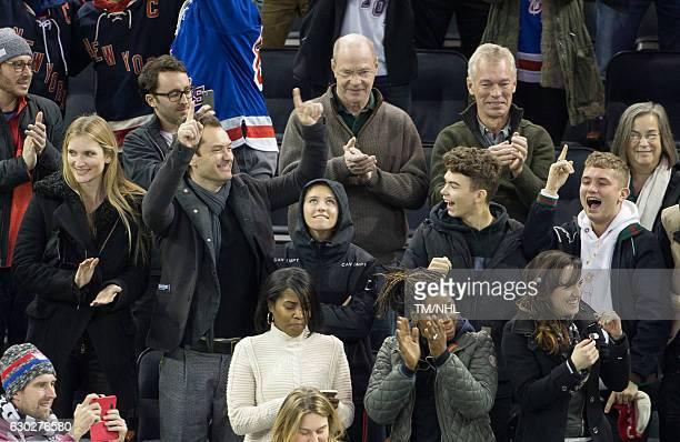 Philipa Coan Jude Law Iris Law Rafferty Law and Rudy Law are seen at Madison Square Garden on December 18 2016 in New York City